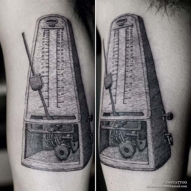 etching metronome tattoo
