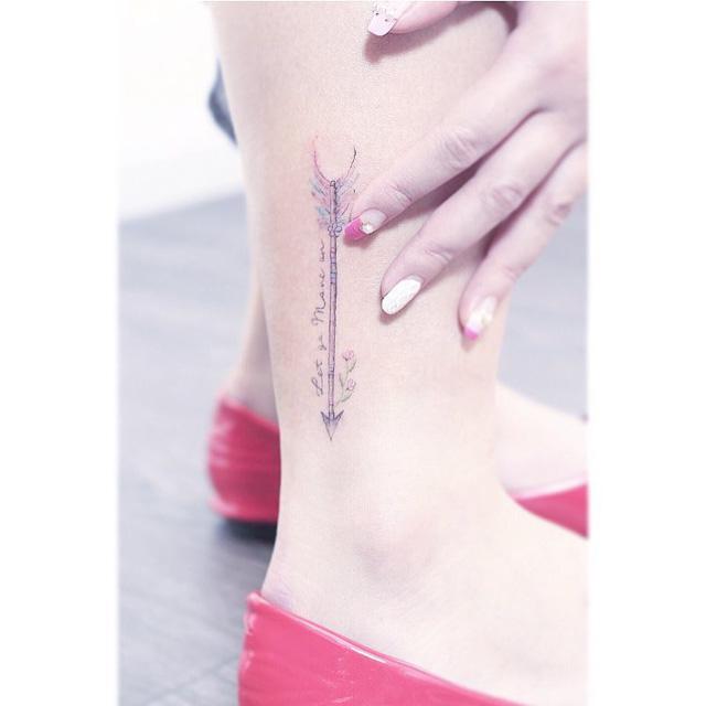 Colorful arrow tattoo