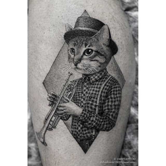 cat tattoo with trumpet
