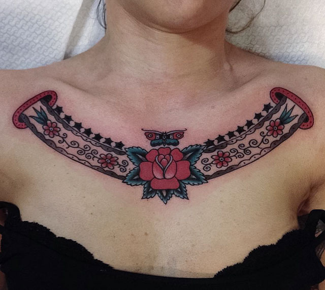 collar bone neo-traditional ribbon tattoo