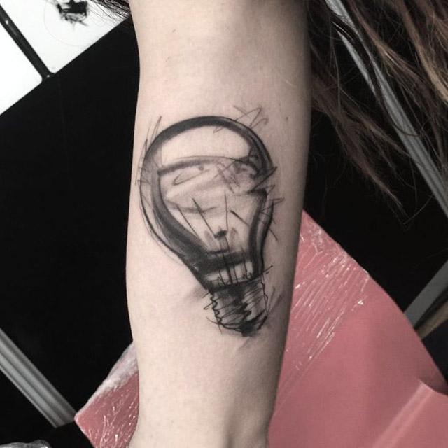grey light bulb tattoo