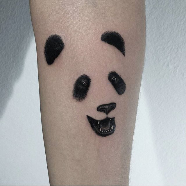 face of panda tattoo on arm