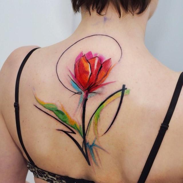 Flower tattoo tulip on back