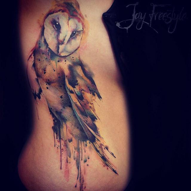 owl tattoo on torso side