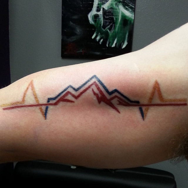 Cardio Mountains Tattoo on BIcep