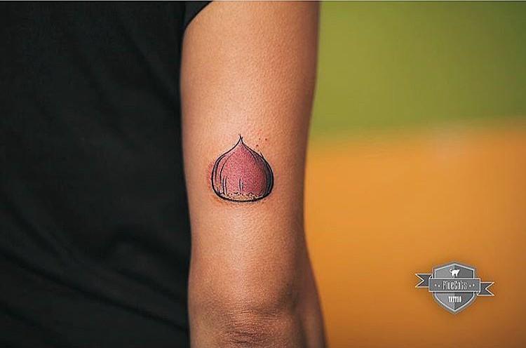 arm tattoo chestnut