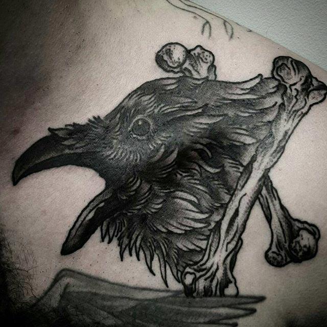 Crossed Bones Bird Tattoo