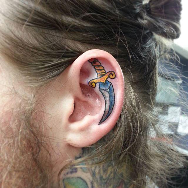 Dagger Ear Tattoo by @kcalverttattoos