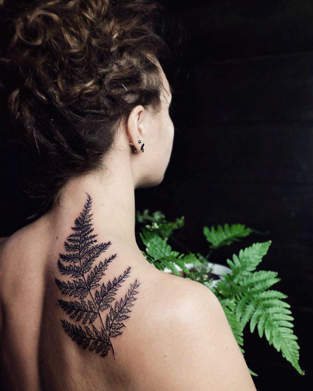 fern tattoo on back