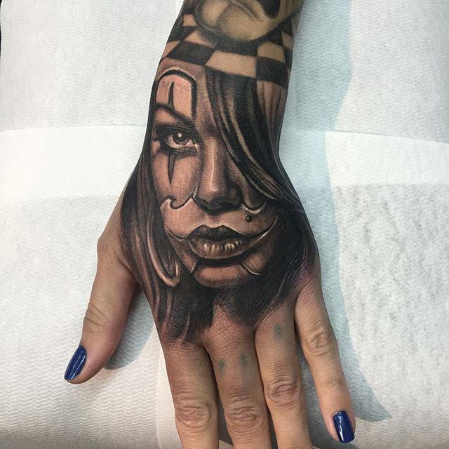hand tattoo Chicano girl