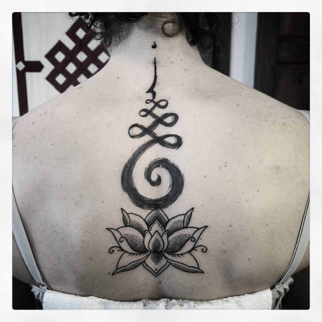 hindu lotus tattoo on back