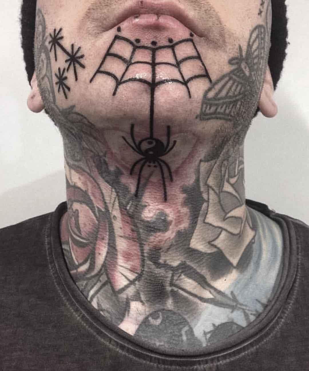 chin tattoo spider web