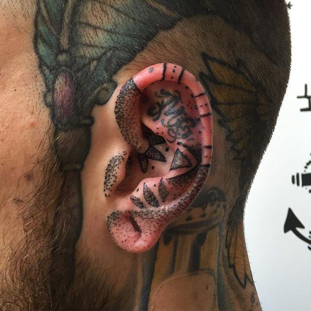 Tattoo in Ear by @ruthredtattoo
