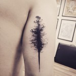 Black Oblong Stain Tattoo on Tricep