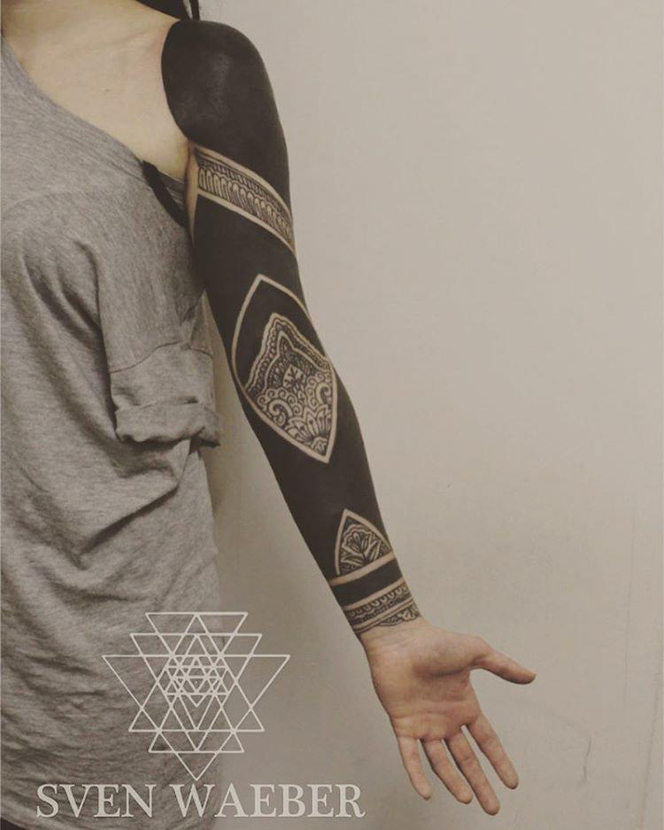 arm tattoo sleeve blackwork