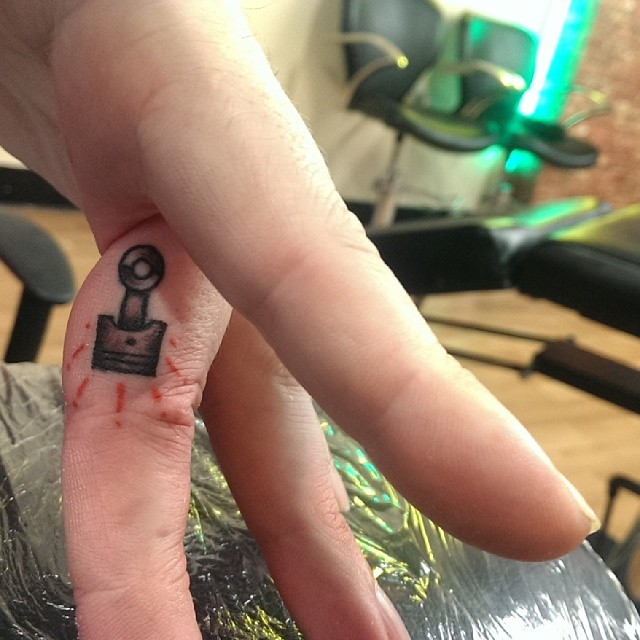 Finger Tattoo Piston by Luke Brundish