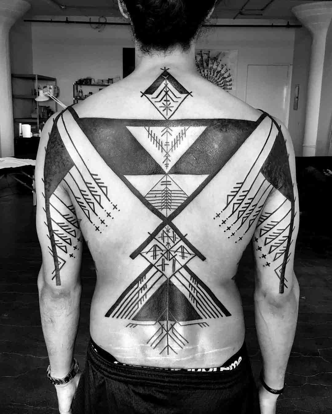 blackwork ethnic pattern tattoo on full back