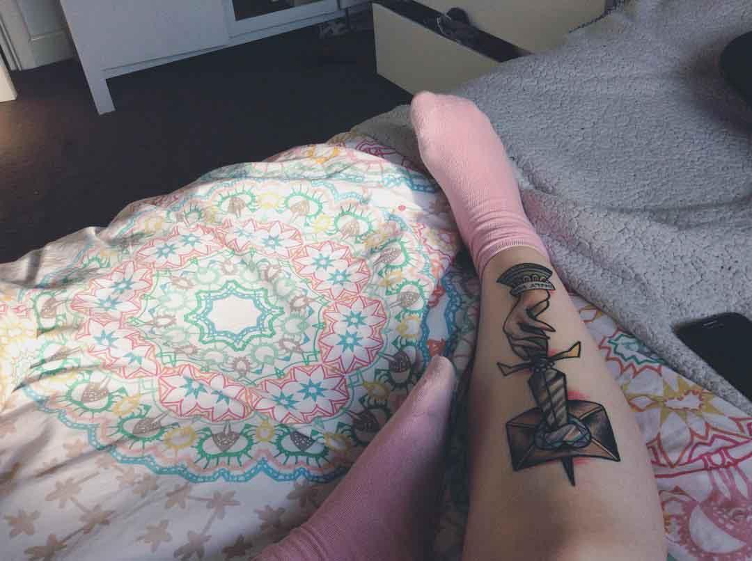 Hand With Dagger Tattoo on Shin