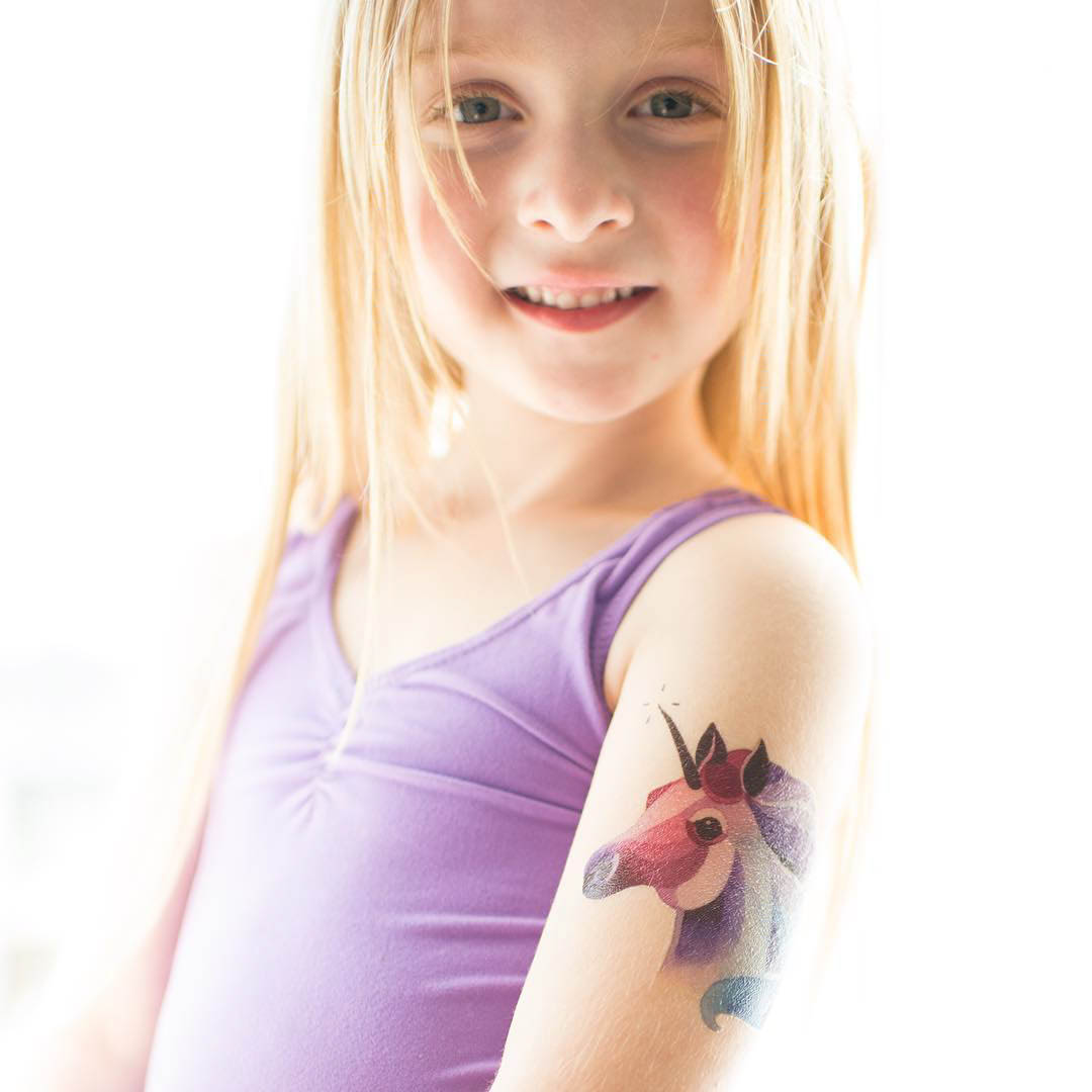 kid with a unicorn tattoo