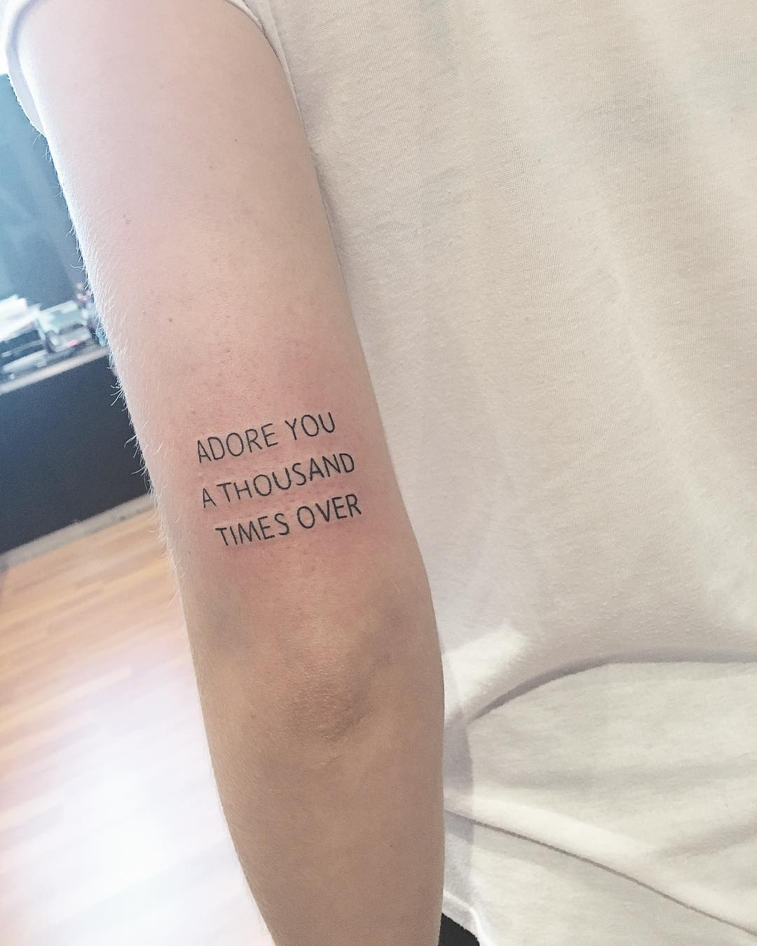 Lettering Tattoo on Tricep by cholo_ink