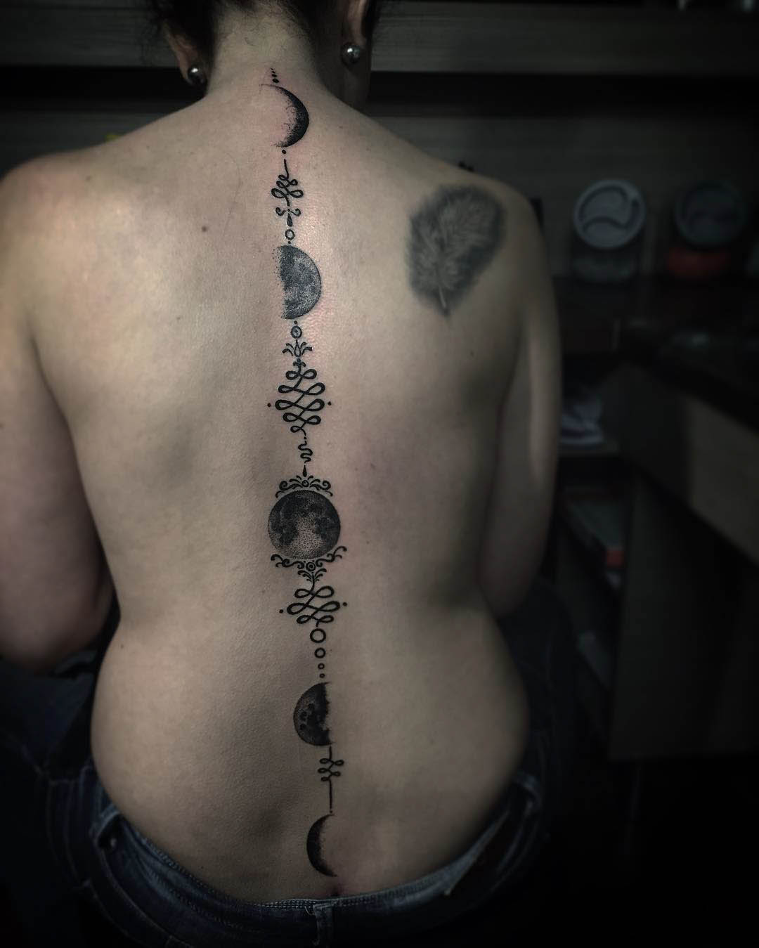 Moon Phases Tattoo on Spine by danistattoo