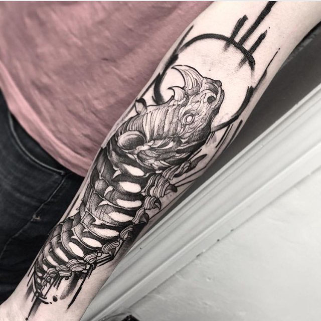 arm tattoo rhino caterpillar