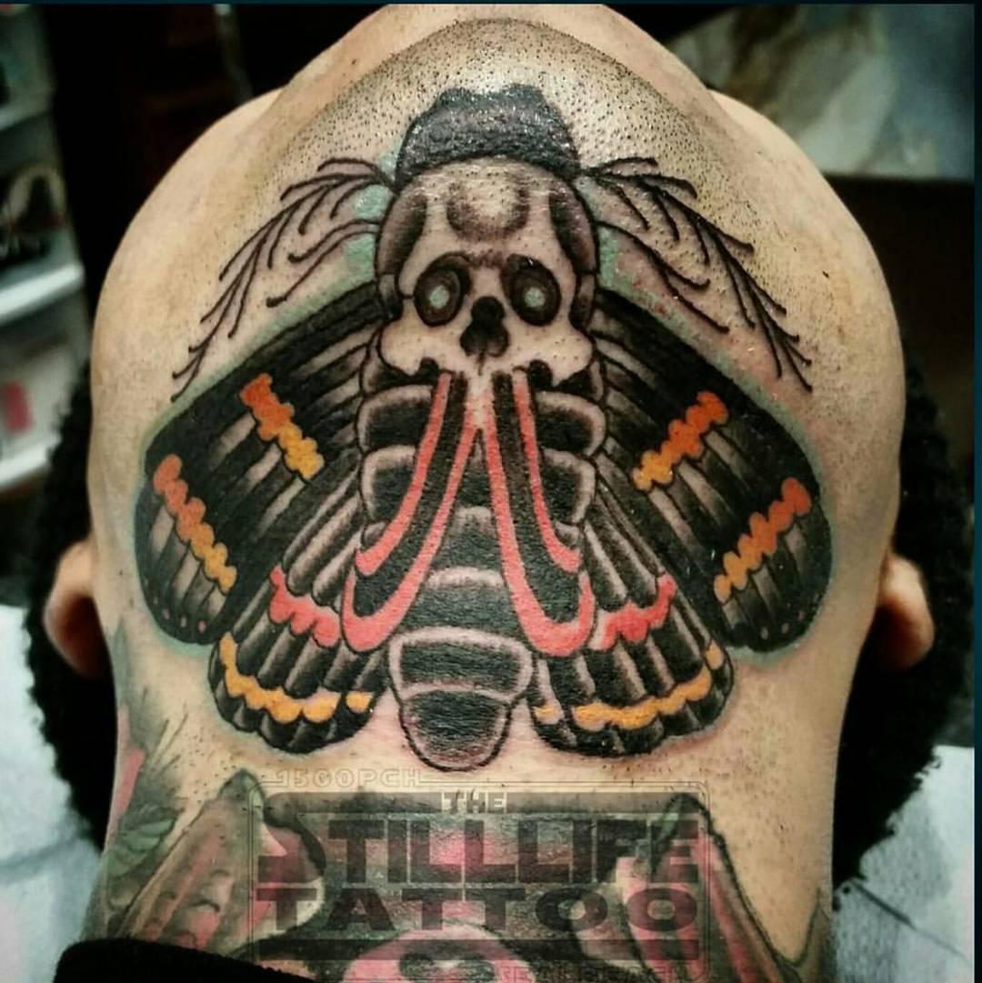Skull Moth Tattoo Under Chin by @shelltoon
