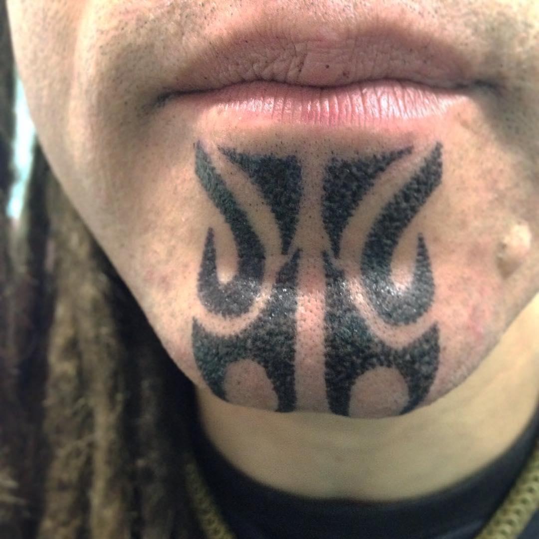 Tribal Chin Tattoo by aidaguidusbodyarts