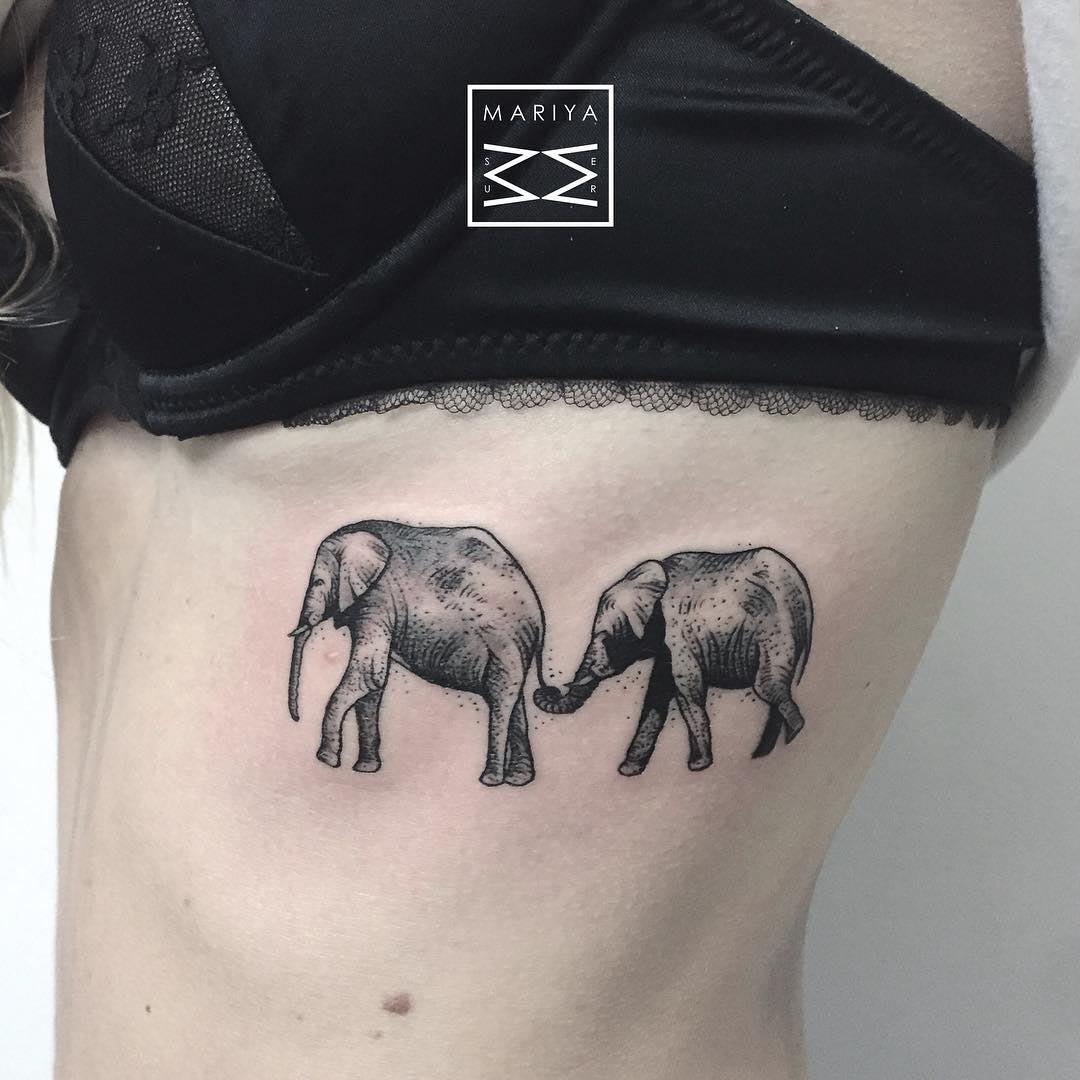 rib tattoo elephants