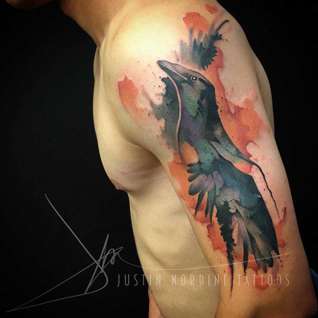 watercolor raven tattoo on shoulder