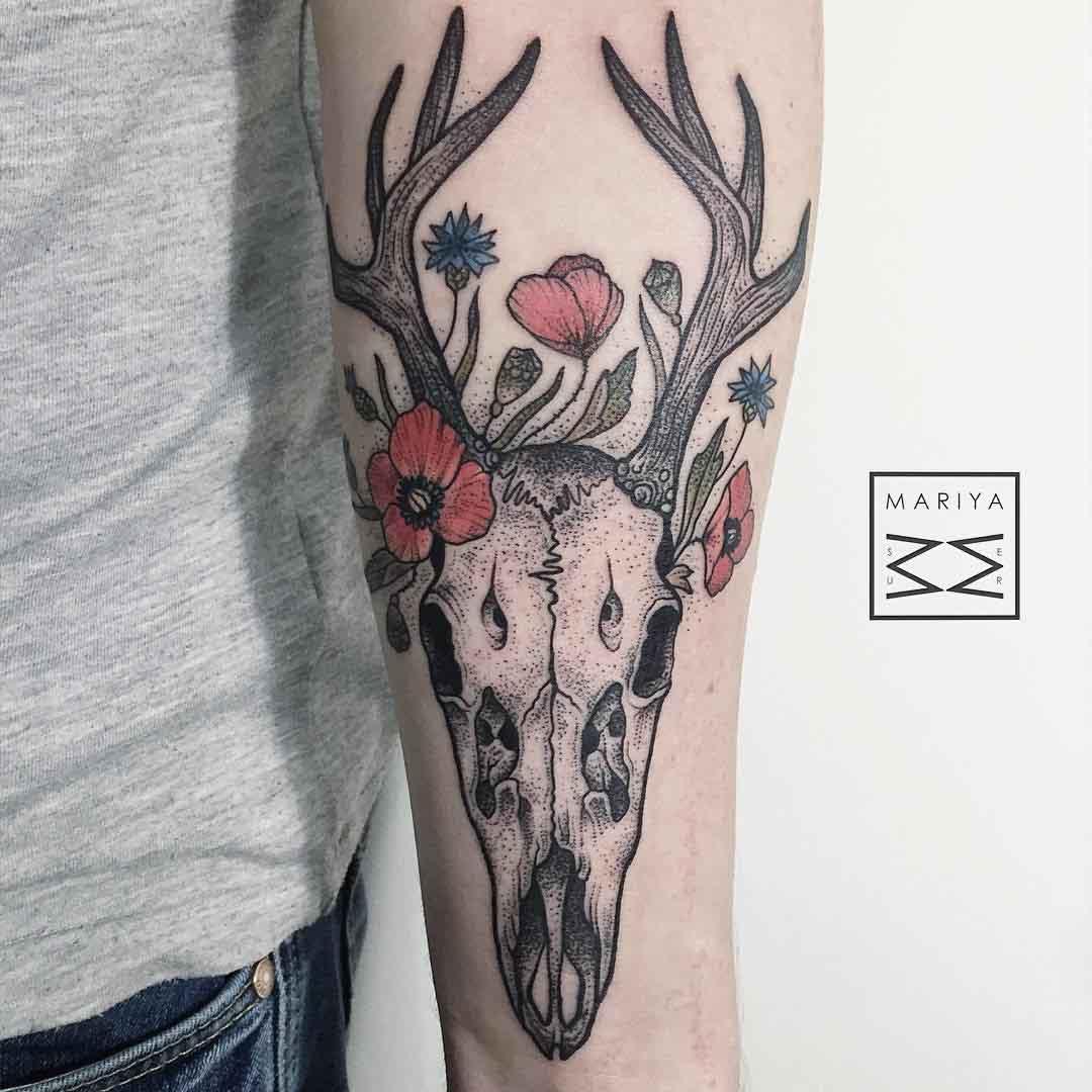 arm tattoo skull deer