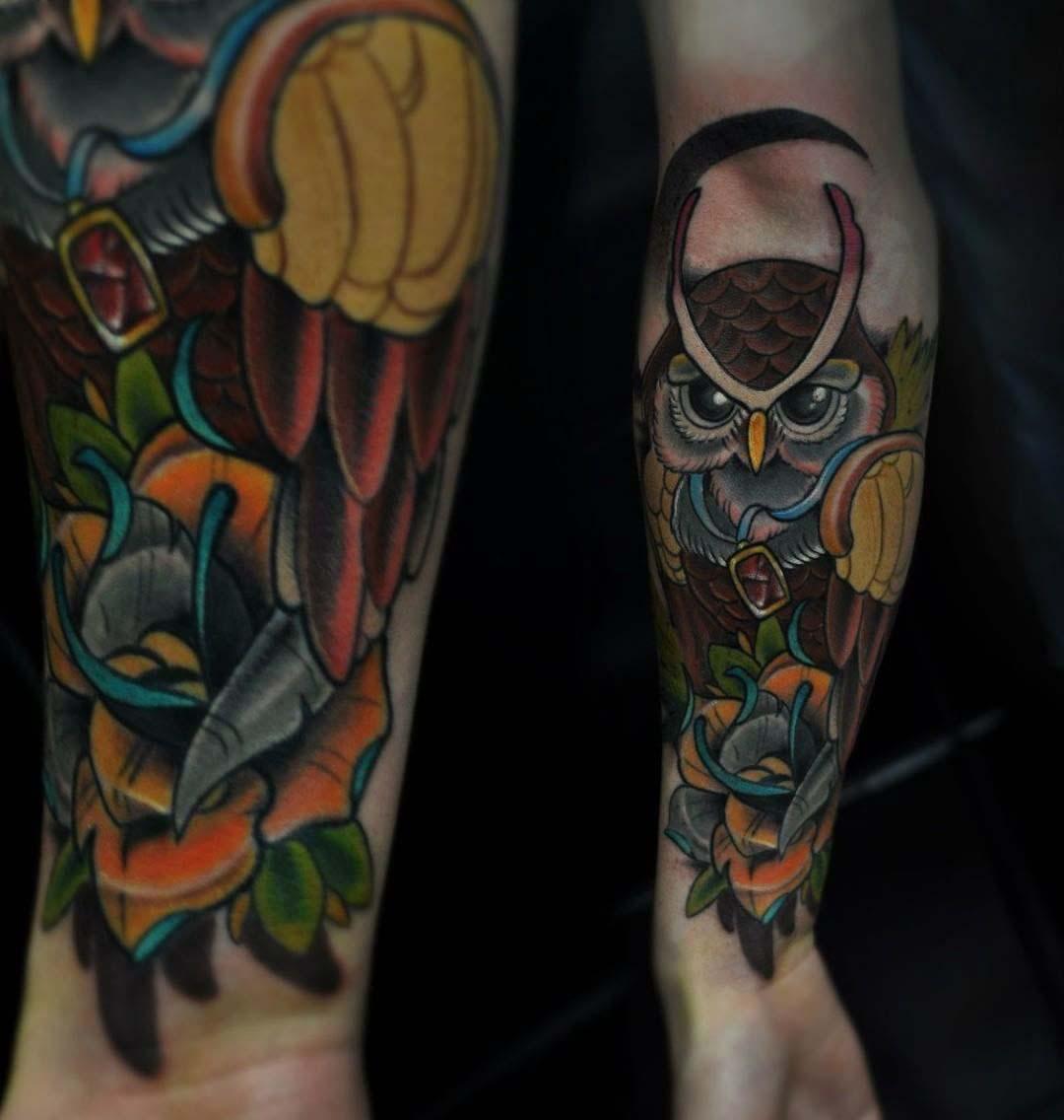 cool owl tattoo on forearm