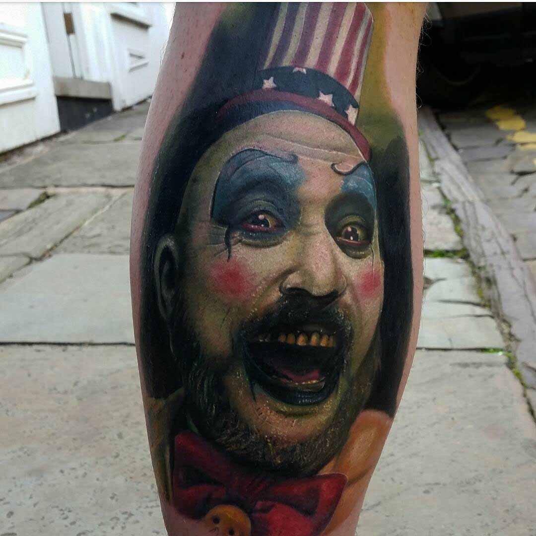 realistic clown tattoo on leg