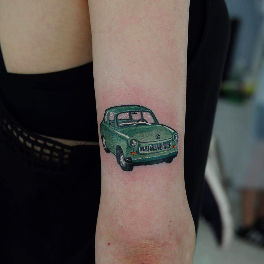 green car tattoo on arm