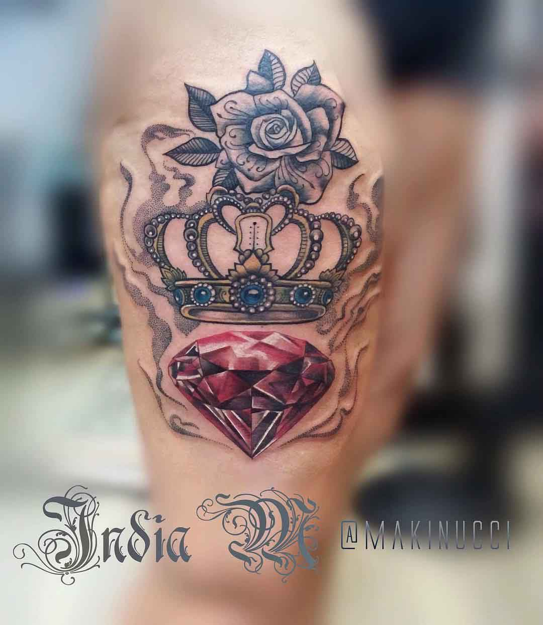 royal crown tattoo with ruby