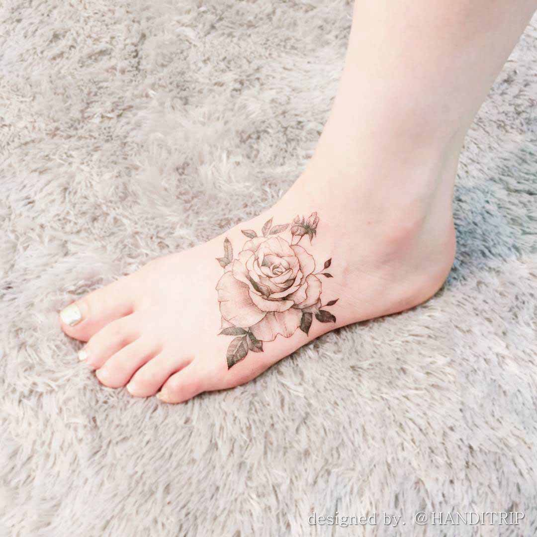 vintage rose tattoo on foot