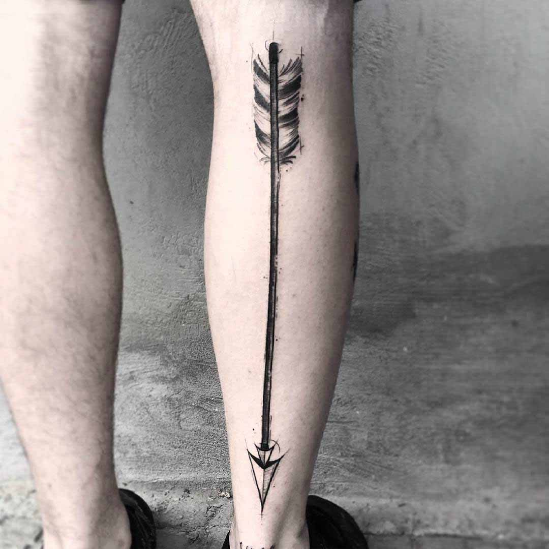 leg tattoo arrow