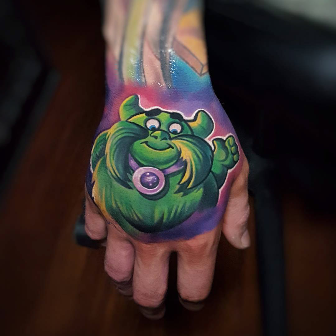 hand tattoo cartoon candy land