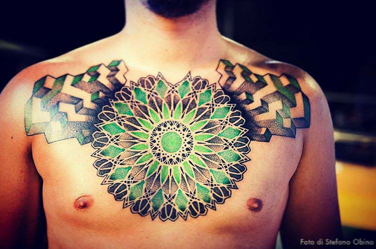 green mandala tattoo on chest