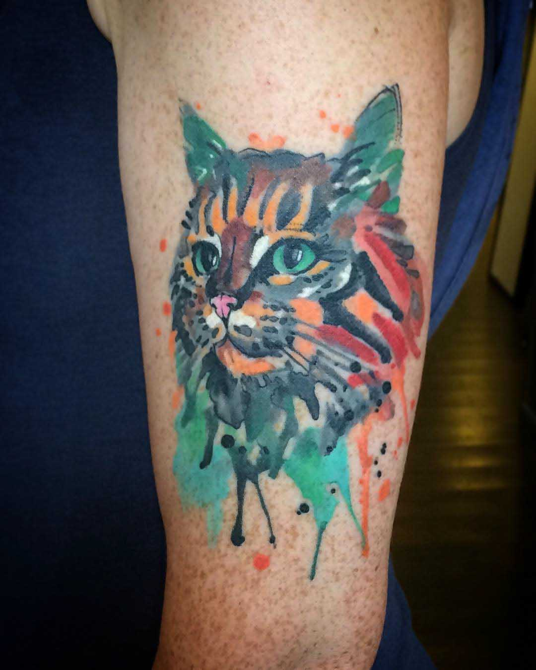 watercolor cat tattoo on arm