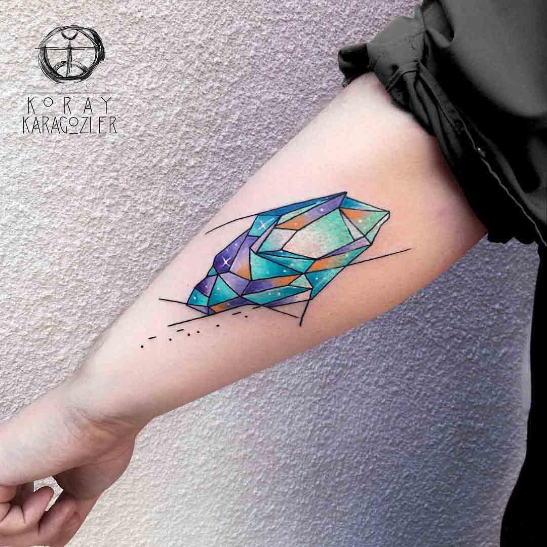 back arm crystal tattoo