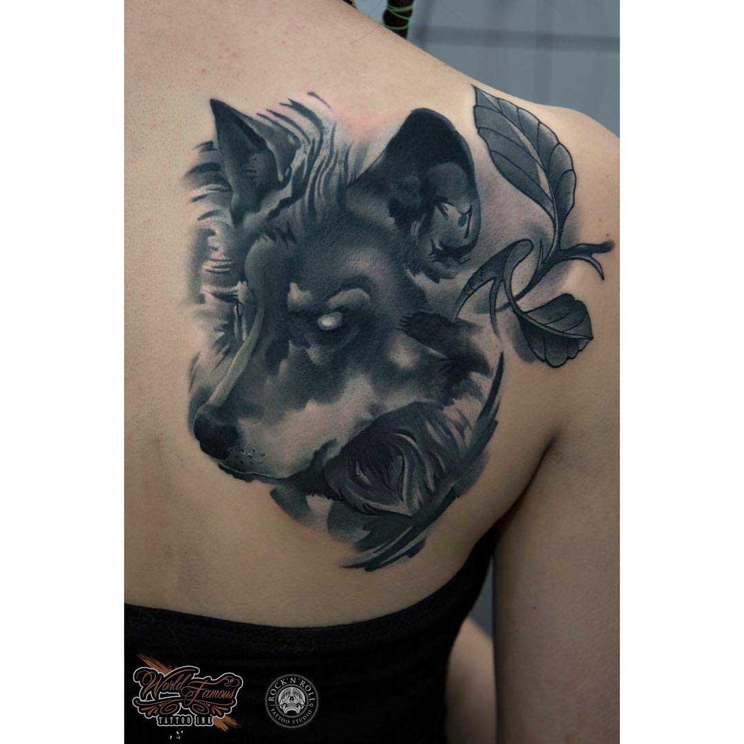 shoulder blade wolf evil tattoo