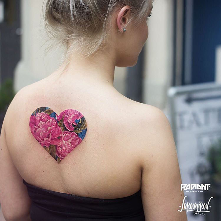back hearts flower tattoo