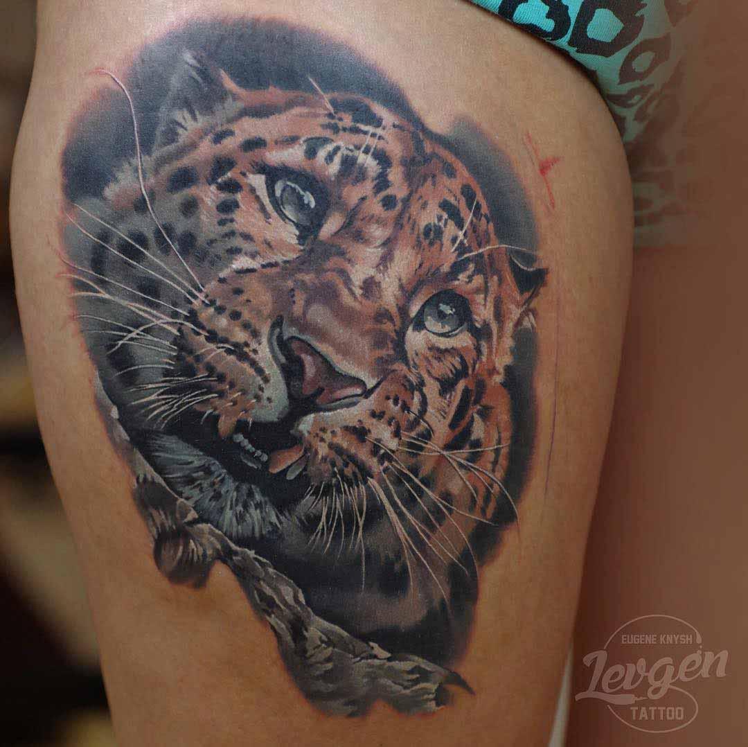 thigh tattoo leopard