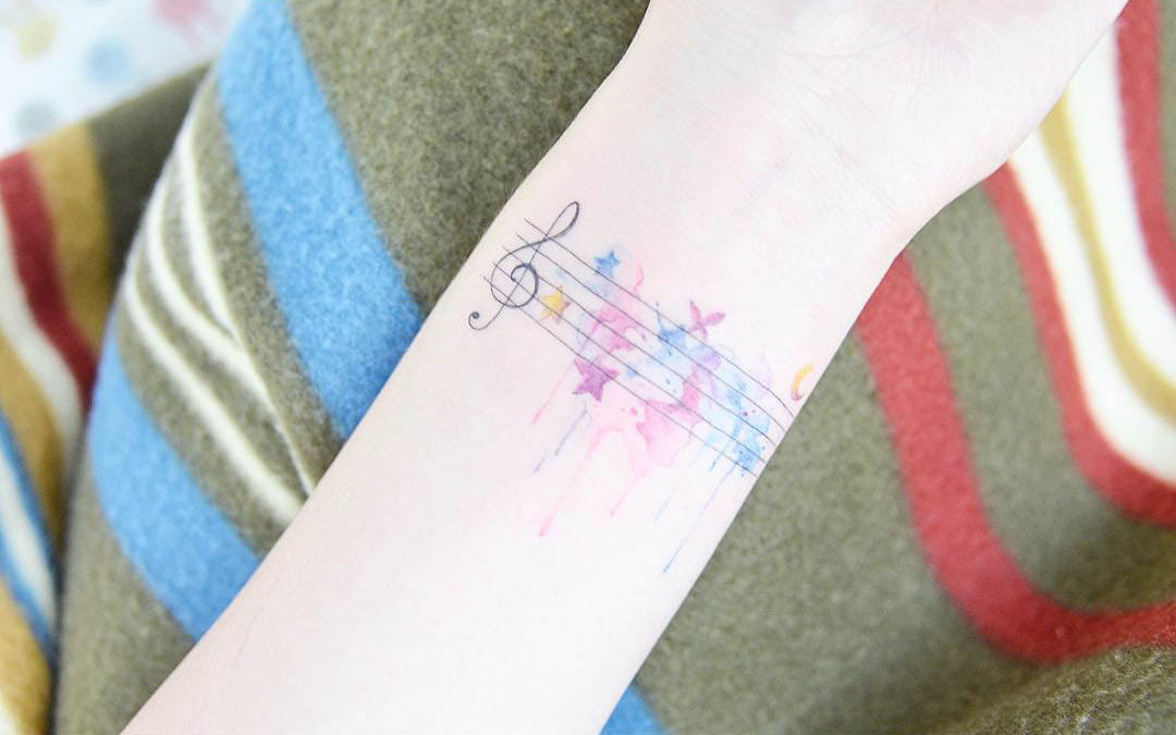 soft wrist tattoo musical themed