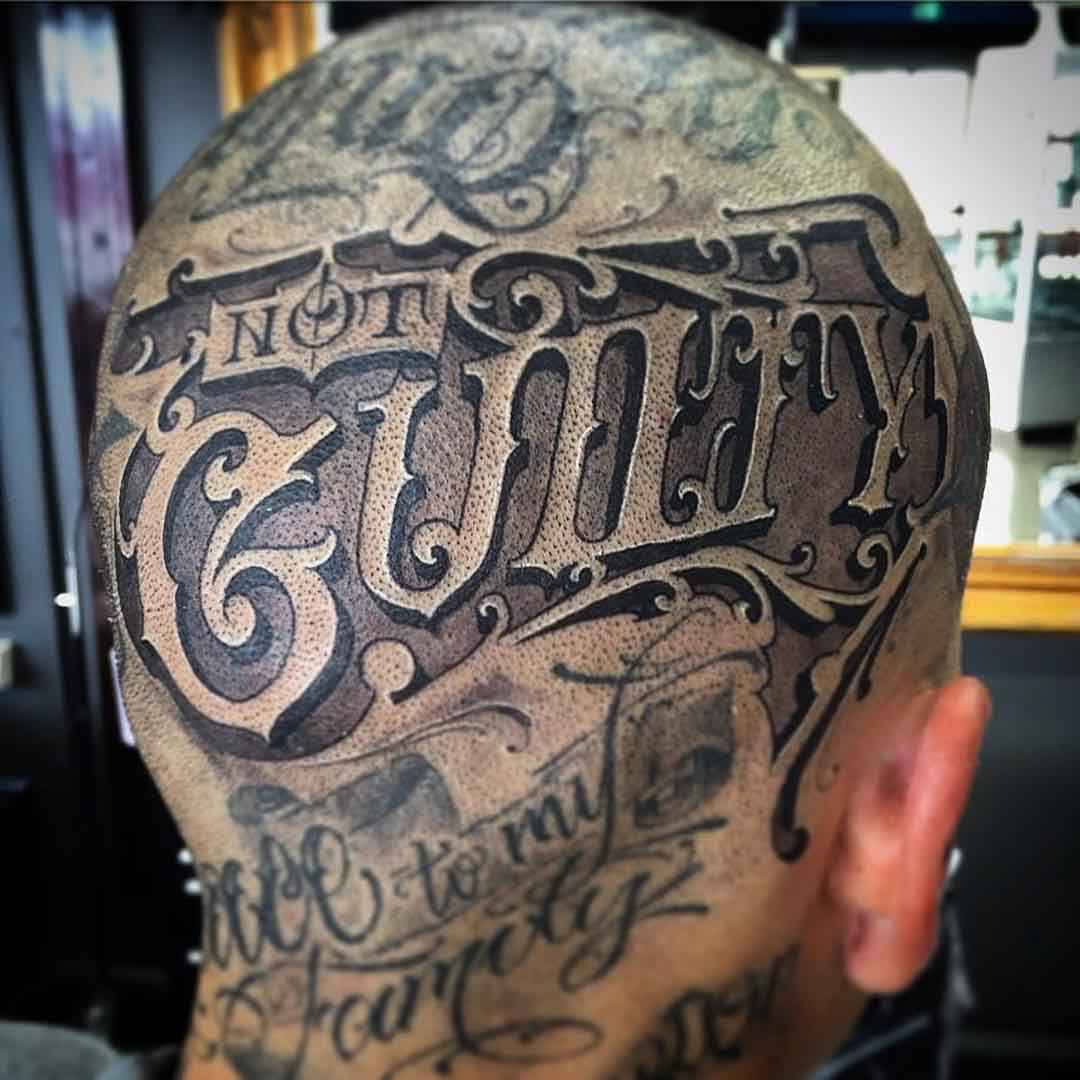 lettering head tattoo on guilty