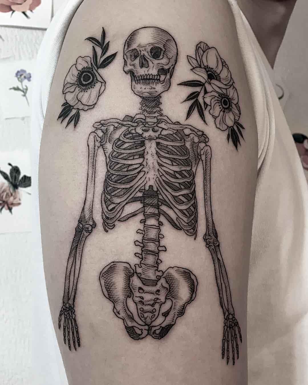 shoulder skeleton tattoo with flowers