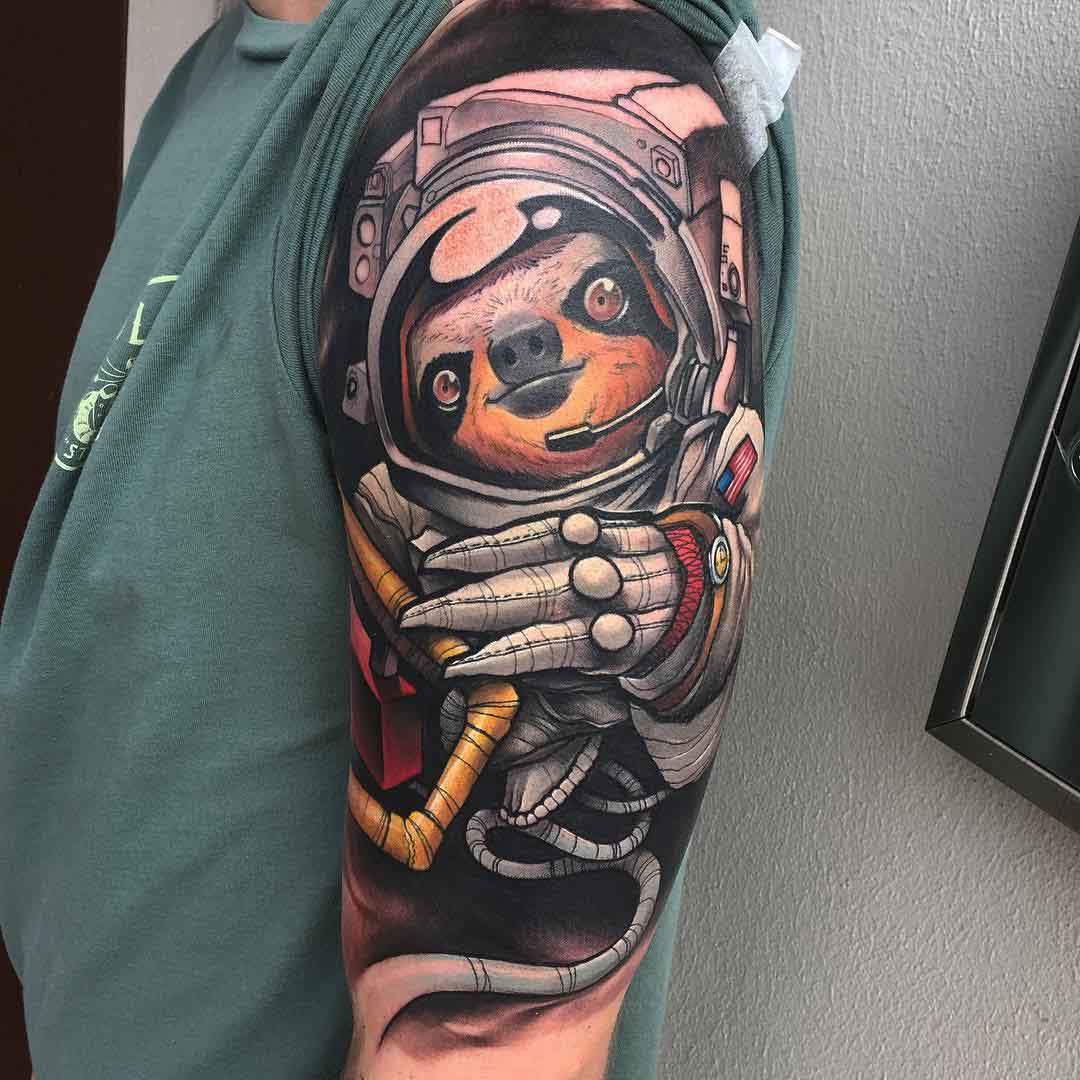 sloth tattoo in astronaut suit
