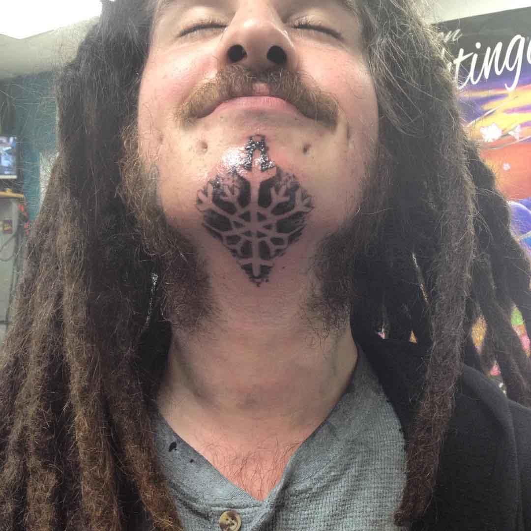 Snowflake Tattoo Under Chin by holydreadlocksbatman
