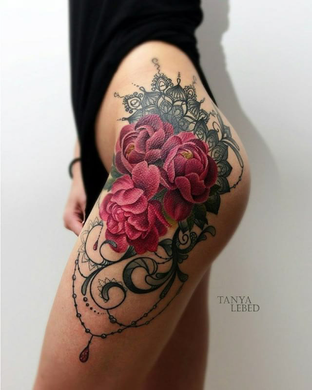 flowers tattoo on hip with baroque elements